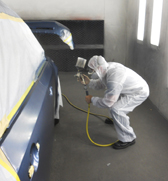 spraying paint in autobody shop